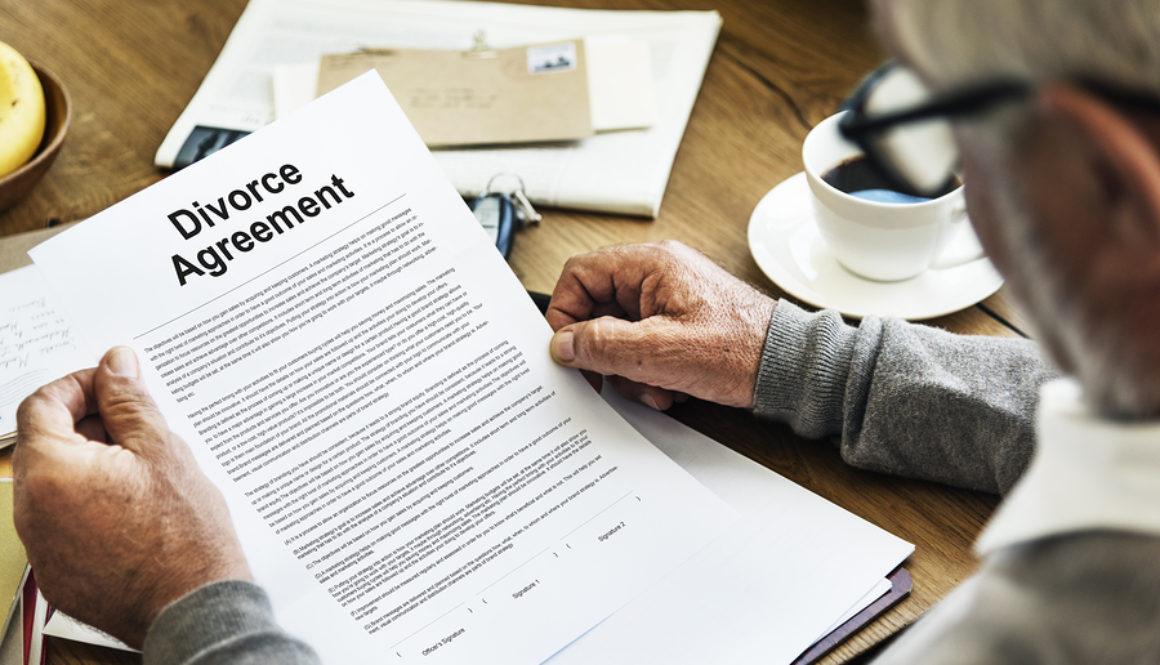Man Holding Divorce Agreement